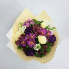 this is a stunningly presented bouquet of mixed purple cream and whites.