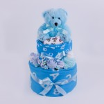 Nappy cake with teddy bear in blue.