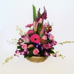 Basket of oriental lilies, roses, gerberas and orchids.