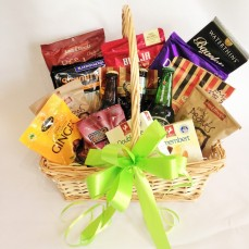 Hamper of beers, cheeses and other savoury and sweet items.