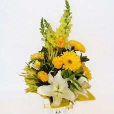 Yellow lilies, gerberas and roses.