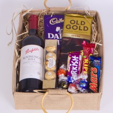 Hamper with bottle of red wine and chocolates.