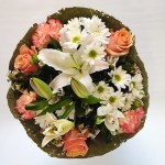 Pastel bouquet encased in lotus leaf.