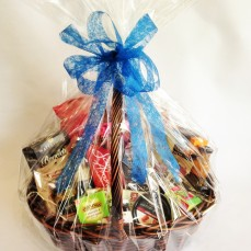 Hamper includes cheeses, savoury biscuits, tea, coffee, chocolates and jam.