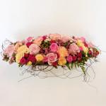 Romantic roses in a ceramic bowl.