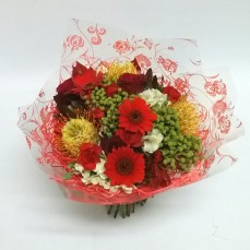Its looking a lot like Christmas with this stunning bouquet. Made with a mix of red, green, gold and white flowers. What a great way to spread the Christmas cheer this year.