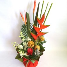 This modern tropical arrangement is bright and beautifully presented in our wrapped floralwell container and looks absolutely stunning.