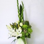 This Crisp white and green modern arrangement would look amazing next to any ones Christmas tree, Presented beautifully in one of our large floralwell boxes.