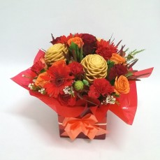 This bold and bright Christmas box arrangement would look very festive on the table this year. Mixed reds with a pop of orange.