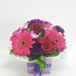 Suprise your mum with this beautiful arrangement of deep puples, pinks and reds.