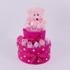 Nappy cake with teddy bear in pink.