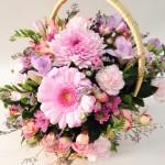 Basket of gerberas and spray roses.