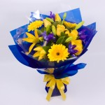 gerberas, lilies, roses and iris.