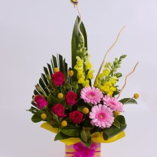 Roses and gerberas with a butterfly ornament.