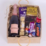Hamper of sparkling wine and chocolates.