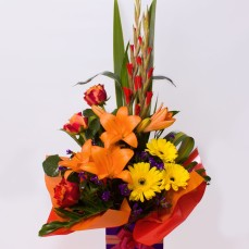 Celebration lilies, roses and gerberas.