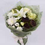 Bouquet in soft whites including Oriental lilies and roses.