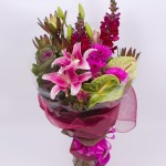 A dramatic and modern bouquet of mixed majestic blooms.
