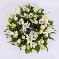 Wreath of white lilies and mixed seasonal flowers