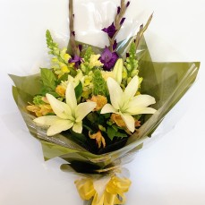 Bouquet of lilies and mixed blooms in creams and yellows.