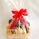 Basket of treats including delicious cheeses, savoury biscuits and chocolates.