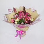 Bouquet in lush pink, deep purple and white tones.