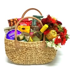 Christmas hamper with a bouquet of flowers a bottle of wine
