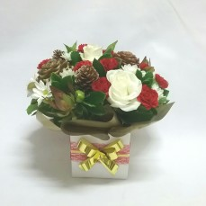 This Christmas box arrangement is a mix of red whites and natural tones. What a great way to say Merry Christmas to the ones you love.